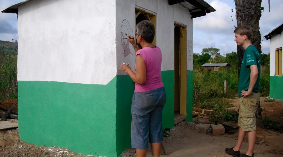 Painting fun and educational murals is part of building volunteer work in Ghana.